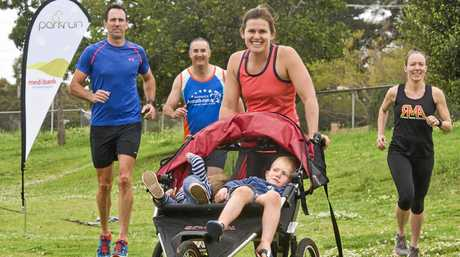STEPPING OUT: Keen to join The Chronicle's Kick the Kilos Campaign are runners (from left) Chris Smith, Ian Wickham, Zoe Burke with Miller, 1, and Farrer, 4, Burke and Monique Tudman.