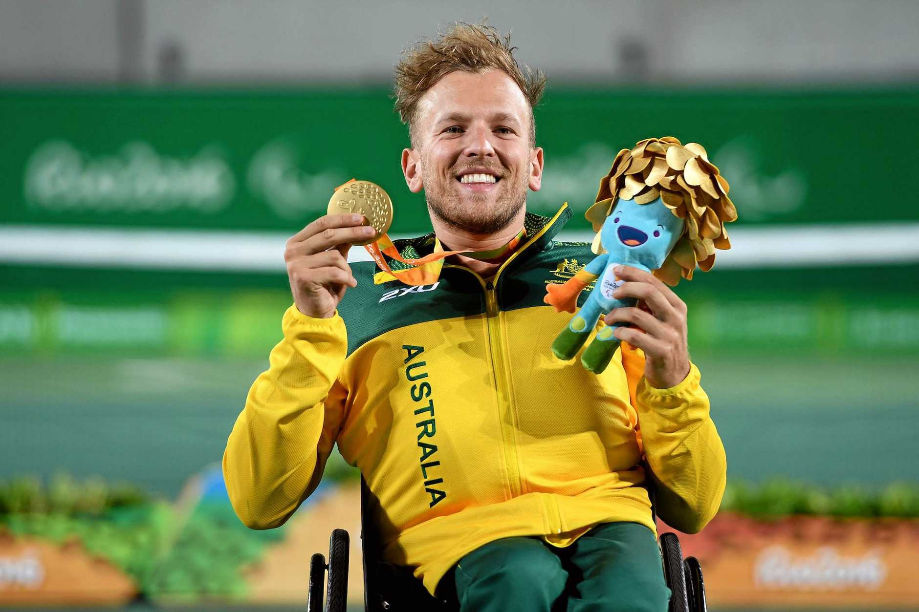 Australian Dylan Alcott shows off his gold medal after deating Andy Lapthorne of Great Britain for the men's quad singles title in Rio.