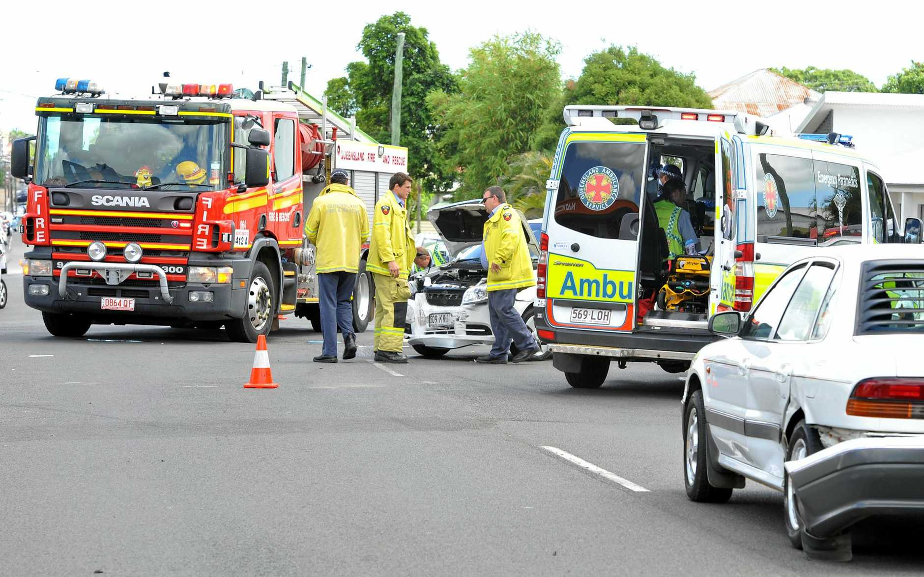 CAR ACCIDENT: Emergency workers at the scene of a 2 car collision on the intersection of Targo st and Burnett st.  Photo: Scottie Simmonds/NewsMail