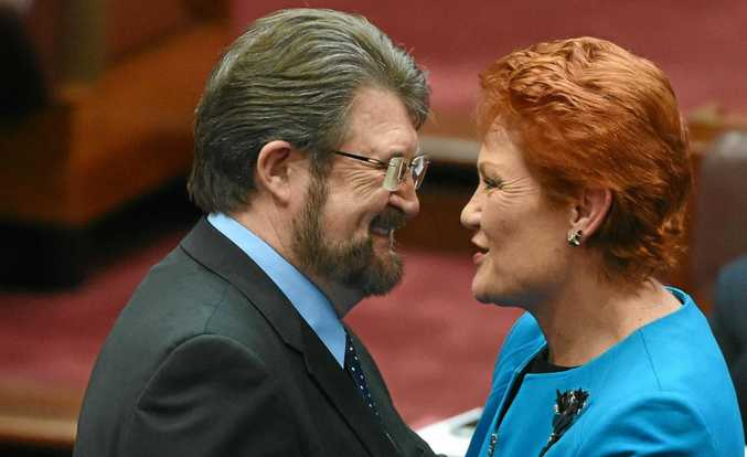 Justice Party Senator Derry Hinch congratulates One Nation leader Senator Pauline Hanson after making her maiden speech in the Senate in Canberra.
