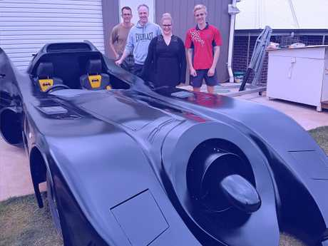 CRIME FIGHTER: Showing off the batmobile are (from left) Craig Blackburn with Hamish Carter and Gabi Elgood from Hot FM and Shaun Blackburn.