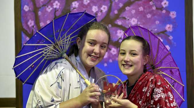 STORY TELLERS: Glenvale State School students Naomi Stephens (left) and Jasmine Cliffe celebrate the school's win at Wakakirri where they told the story of One Thousand Paper Cranes through a story dance.