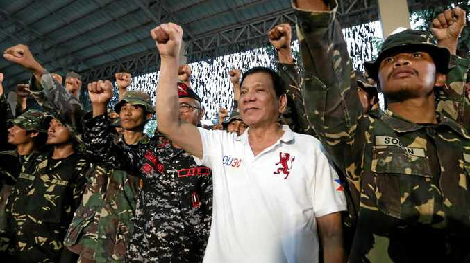 DOING IT HIS WAY: President Rodrigo Duterte enjoys a show of strength with soldiers during his visit to the headquarters of the Philippine Army Scout Rangers in the town of San Miguel.