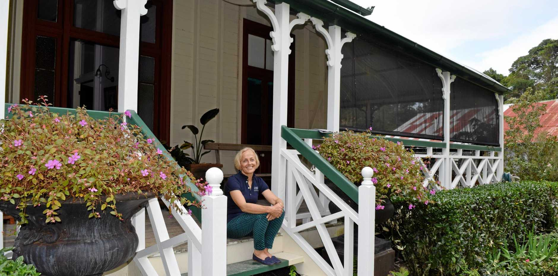 Kim Springhall relaxing on the property she and her husband George have spent the past 21 years transforming into its current state.