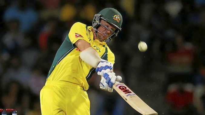 Australia's Travis Head plays a shot against Sri Lanka during their first twenty20 cricket match in Pallekele, Sri Lanka, Tuesday, Sept. 6, 2016. (AP Photo/Eranga Jayawardena)