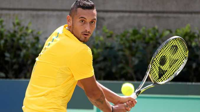 Australia's Nick Kyrgios plays a shot during his Davis Cup tennis match against Slovakia's Andrej Martinin at the Ken Rosewall Arena in Sydney, Friday, Sept. 16, 2016. (AAP Image/David Moir) NO ARCHIVING, EDITORIAL USE ONLY