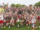 DELIGHTED DANES: Pittsworth players celebrate winning the Hutchies-Chronicle Cup at Clive Berghofer Stadium.