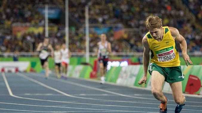 James Turner of Australia collapses after winning the Men's 800m - T36 Final with the World record of 2:02.39 during the Athletics competition at the Olympic Stadium during the he Paralympic Games, Rio de Janeiro, Brazil, Saturday 17th September 2016.
