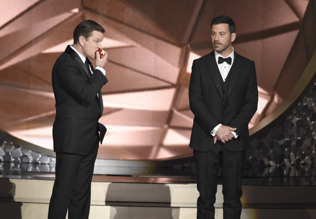 Matt Damon, left, and host Jimmy Kimmel appear on stage at the 68th Primetime Emmy Awards in Los Angeles.