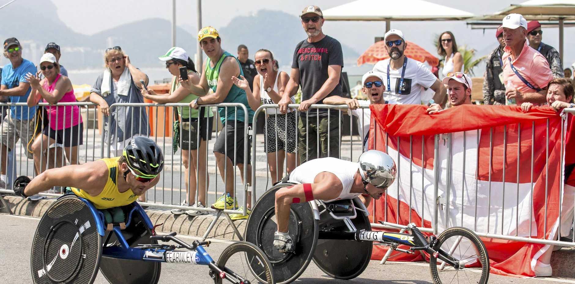 Australia's Kurt Fearnley (left) and Switzerland's Marcel Hug compete in the marathon T54 race.