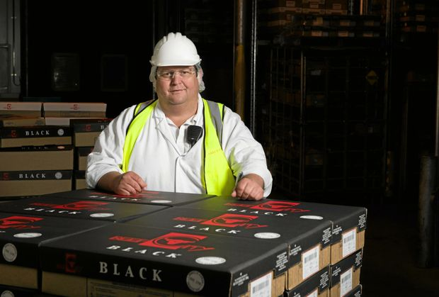 BEST BEEF: Beef City plant manager Justin McCormick with cartons of Beef City product which was awarded at the 2016 Australian Fine Food Awards.