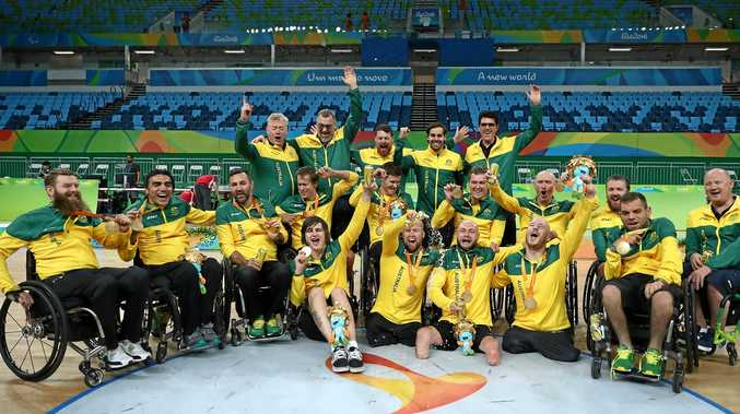 Team Australia celebrates after winning the match against the United States in the men's wheelchair rugby gold medal match at the Rio 2016 Paralympic Games.
