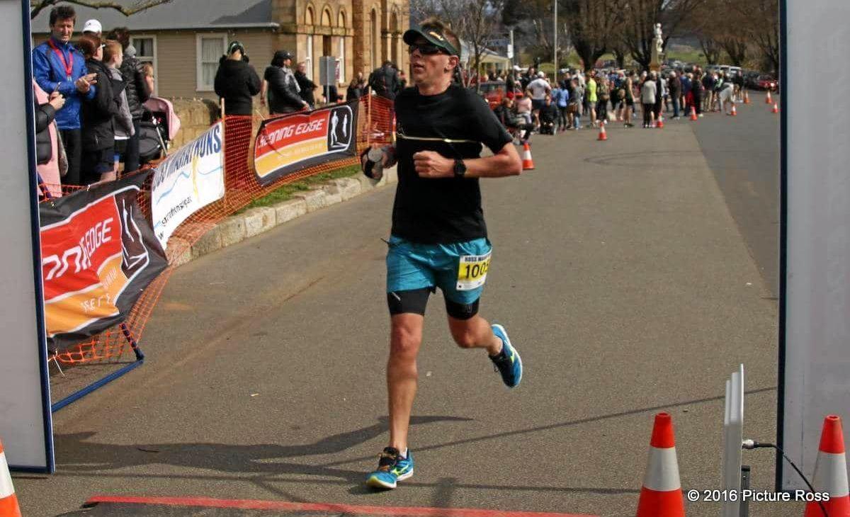 KICKING IT: Rockhampton Road Runner president Matt Arnold in the Ross Marathon (Tasmania) where he achieved his PB of 3:34:5 at the start of this month.