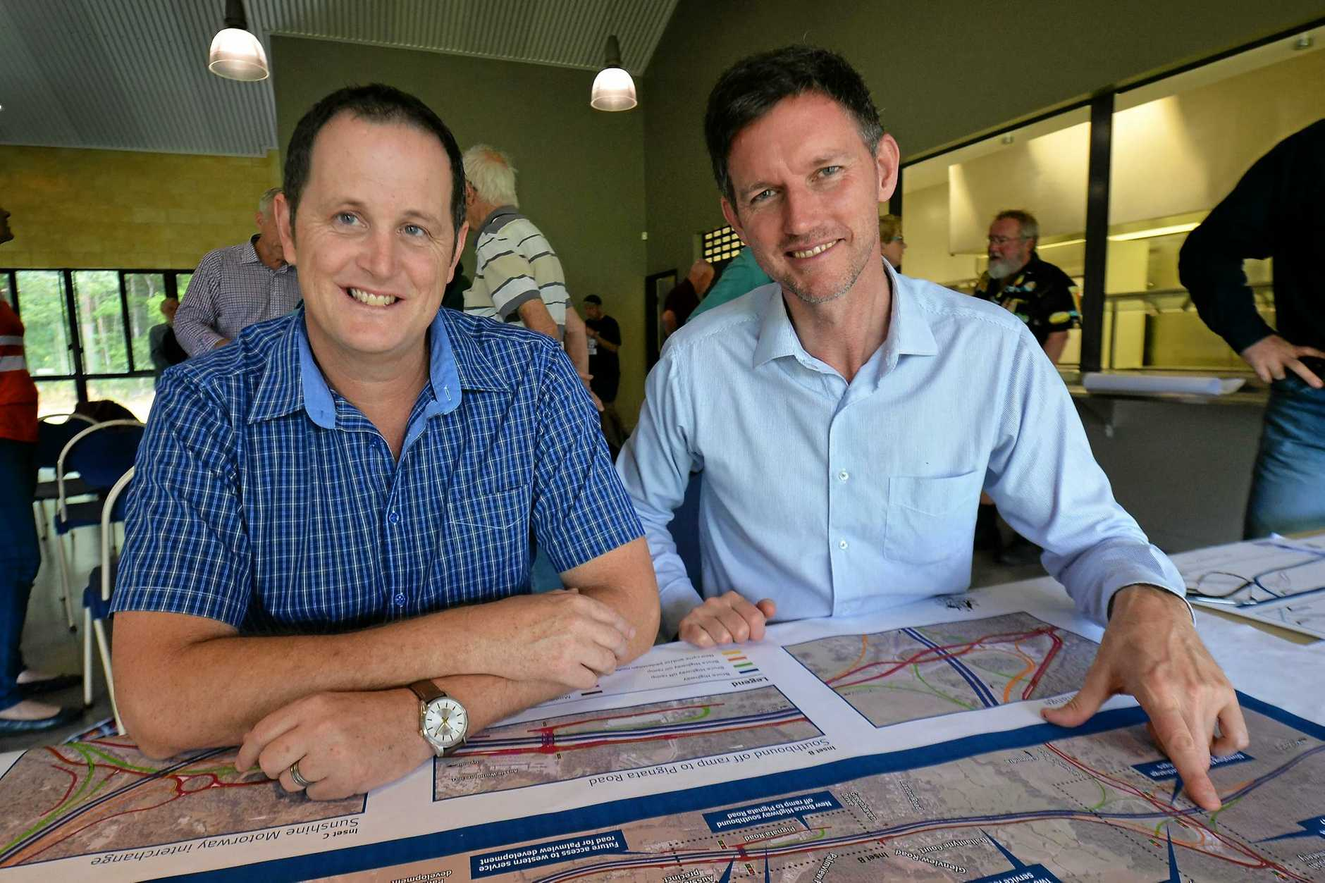 Main Roads Minster Mark Bailey with Caloundra Labor branch head Jason Hunt look over the Bruce Highway plans revised after extensive community consultation.