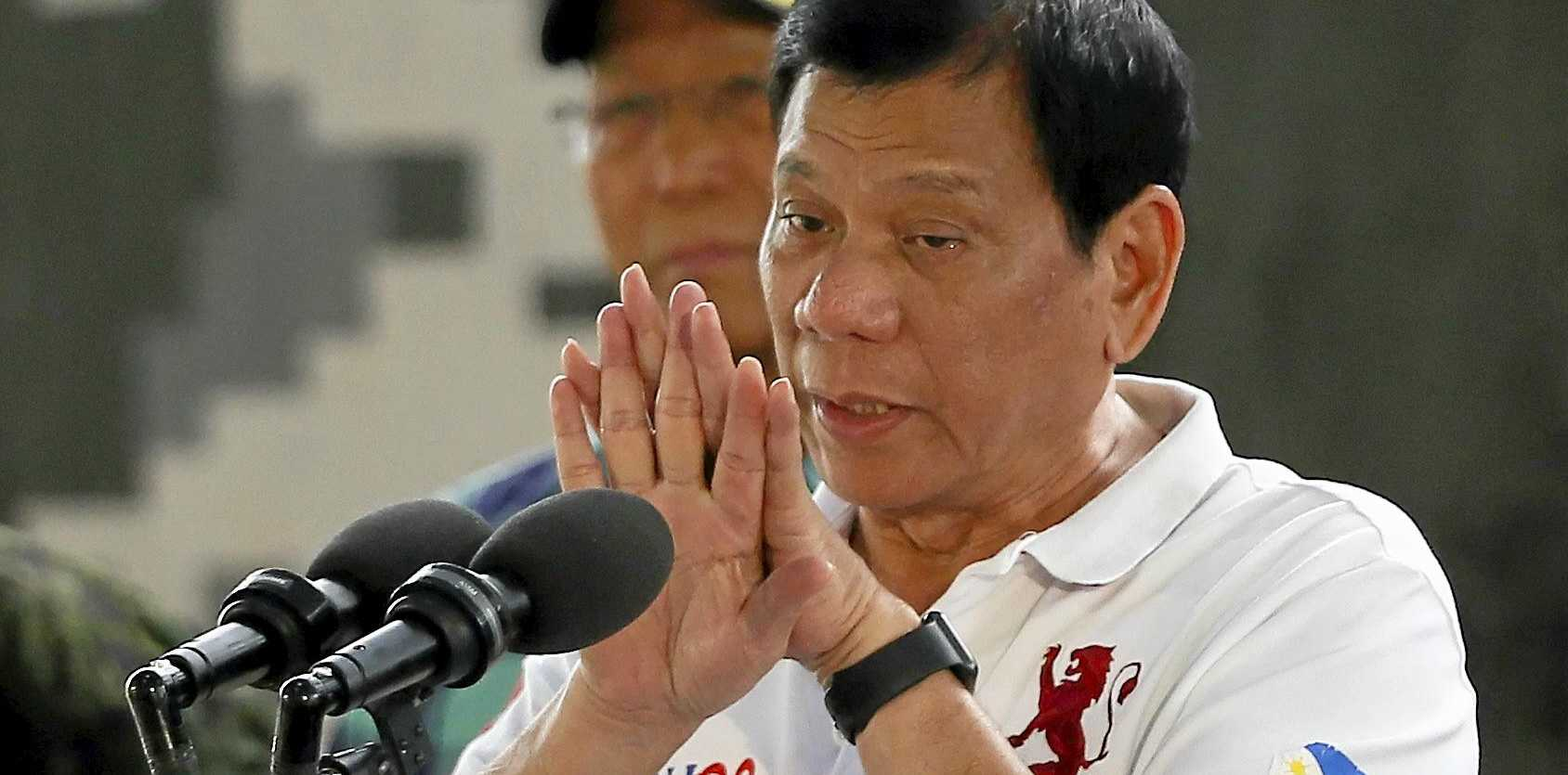 Philippine President Rodrigo Duterte gestures while addressing the Philippine Army Scout Rangers during his visit to their headquarters at Camp Tecson in San Miguel township, north of Manila, Philippines Thursday, Sept. 15, 2016. A former Filipino militiaman testified before the country's Senate that President Duterte, when he was still a mayor, ordered him and other members of a squad to kill criminals and opponents in assaults that left about 1,000 dead. (AP Photo/Bullit Marquez)