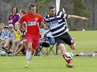 MIDFIELD DUEL: Majos Thunder's Bryce Jones puts pressure on Yuraygir United's Bill North during the NCF 2nd Division grand final.