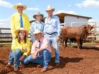 Chris and Elisa Fox, Cooinda Santa Gertrudis, Proston, with Cyril Close, Top X Roma, who sold Cooinda Low Flying Duck (P) to Ray and Susan Mayne, Graceview, Kingaroy, for a second top of $18,000.