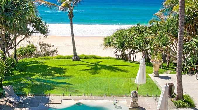 The property overlooks Sunshine Beach, as the backyard lawn meets the sand.