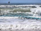 The first section of the Lennox Head trial shark barrier being installed before ultimately washing away.