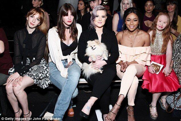 Madeline Stuart rose to fame and was once again a star at New York Fashion Week, sitting among friends - Kelly Osborne, Bonang Matheba, Derek Warburton, and Victor Cruz,