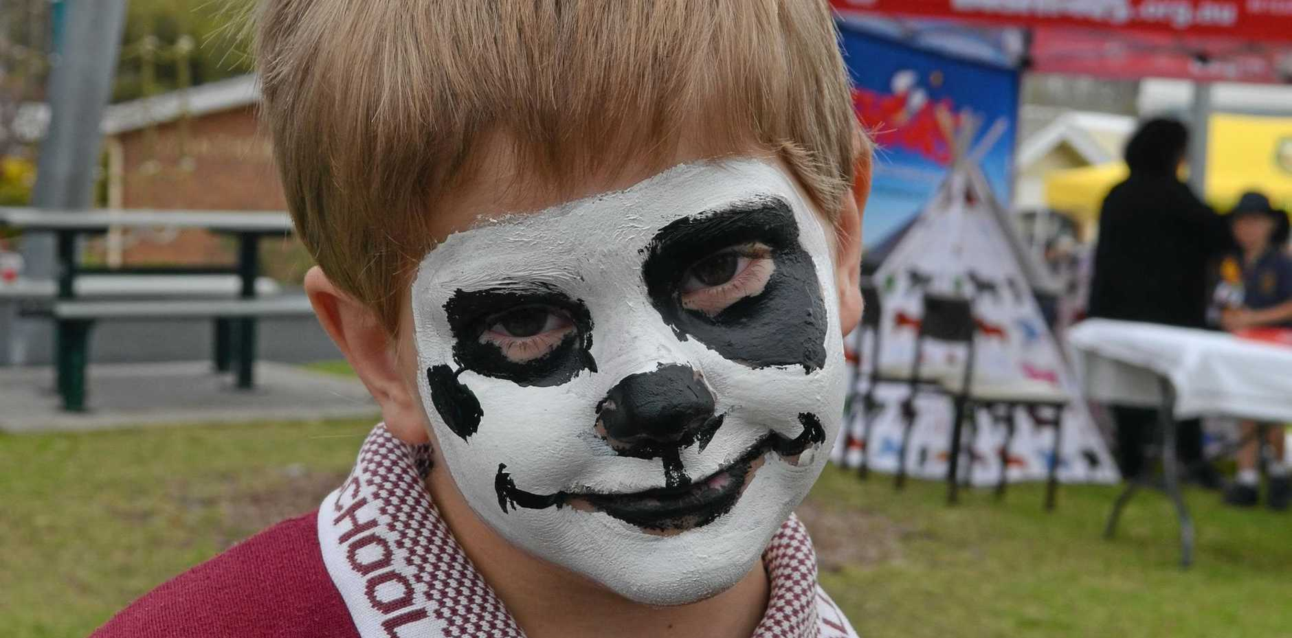 NEW FACES: Tyler Purcell from Wallangarra State School had his face painted as a skeleton dog at the Under 8s Day.