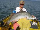 BIG BARRA: Julie Harrison landed this impressive 1.21m barramundi at the dam.