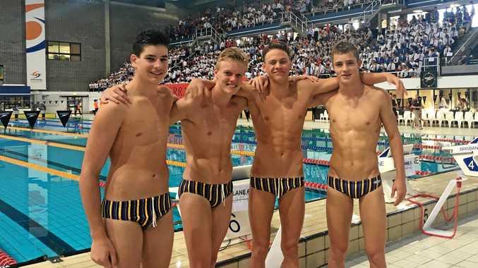 Toowoomba Grammar swimmers Tom Wilson, Josh Smith, Fraser Stewart and Simon Geldenhuys celebrate their 16 years relay winning swim earlier this year.