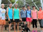 RAIN WON'T STOP 'EM: Emerald Runners (from left) Craig Firth, Craig Drummond, Byron Rackley, Madonna Drummond, Donna Oliver, Emma Burgess and Bronte Usher with Pip the dog.