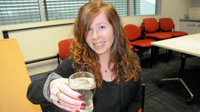 GOOD DROP: Kate Dodd tastes Toowoomba water which was judged Queensland's best.