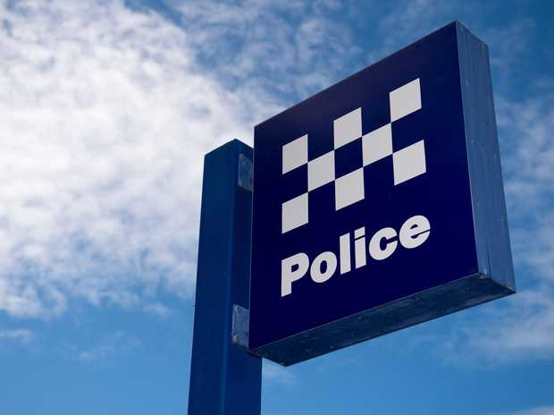 A MAN was injured after a business sign was thrown at him in an unprovoked attack in the Mackay CBD overnight.
