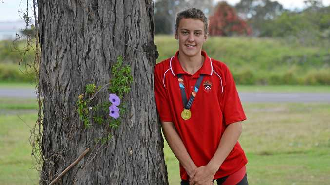 OUT IN FRONT: Ethan Weder with his gold medal after winning the under-16 singles scull at the recent Queensland Schools Regatta at Bucca.