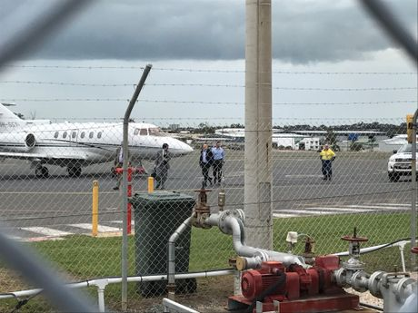 TOUCH DOWN: Treasurer arrives on premier's private plane.