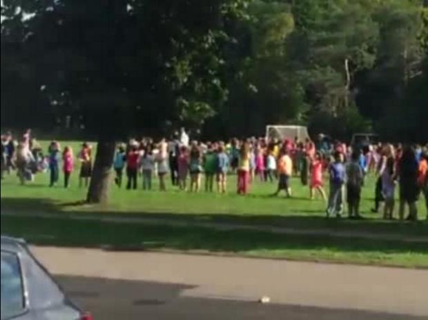 Pupils were herded out of school towards 'safe' designation spots