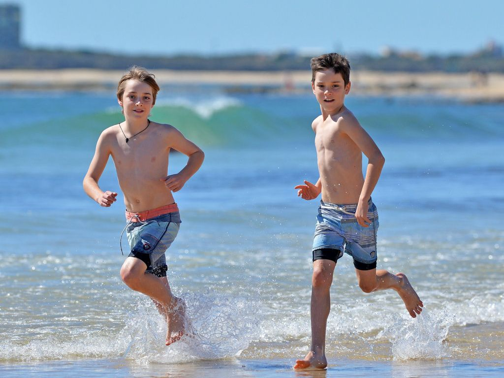 Out and about on school holidays at Alexandra Beacha are Jannet, Joel, 13, and Daniel, 11, McCullock.