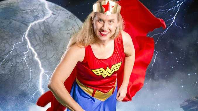 DRESS UP: Paul Knie from Lightscape Studio is bringing some extra magic to Comic Con with a green screen photo booth. Amanda Lewis dresses up as superwoman for a previous event.