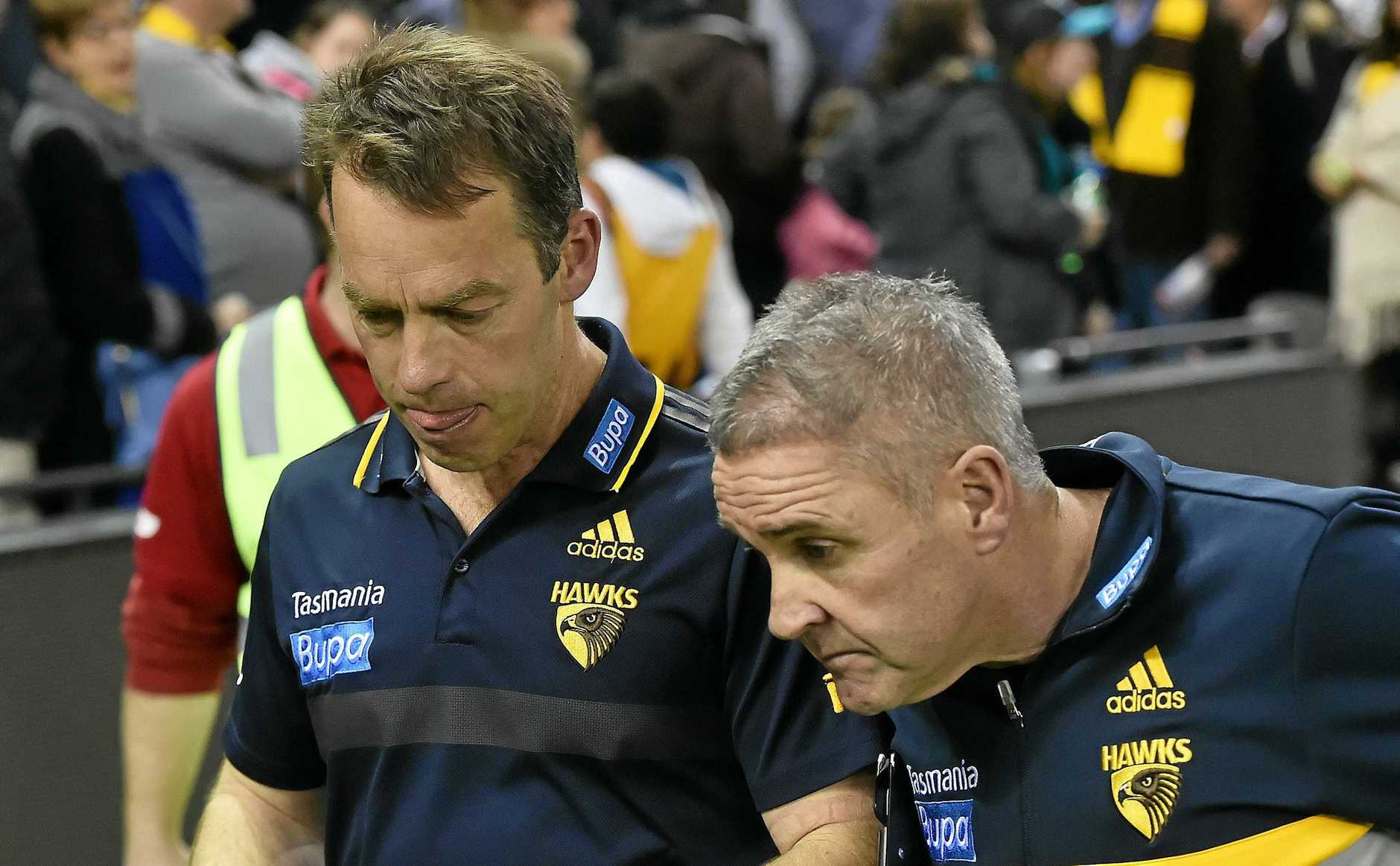 Chris Fagan (right), who is the favourite to take the vacant Brisbane Lions coaching role, with Hawthorn Hawks coach Alastair Clarkson.