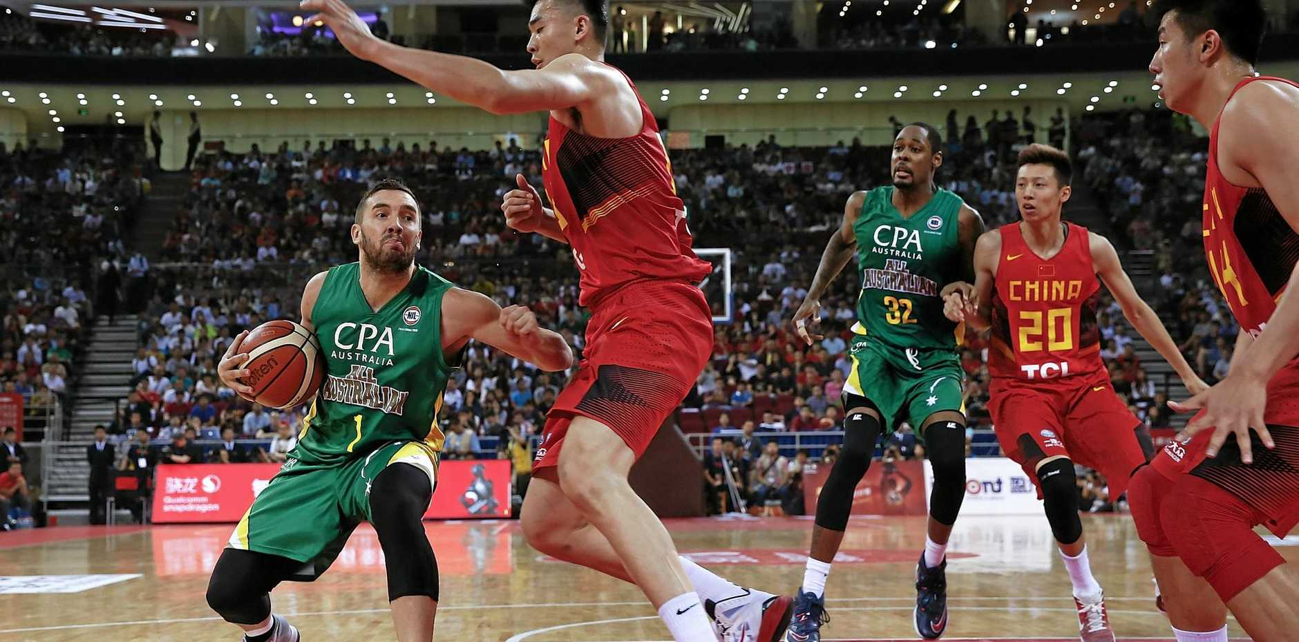 Bullets recruit Adam Gibson of Australia drives to the basket against Li Muhao of China in May.