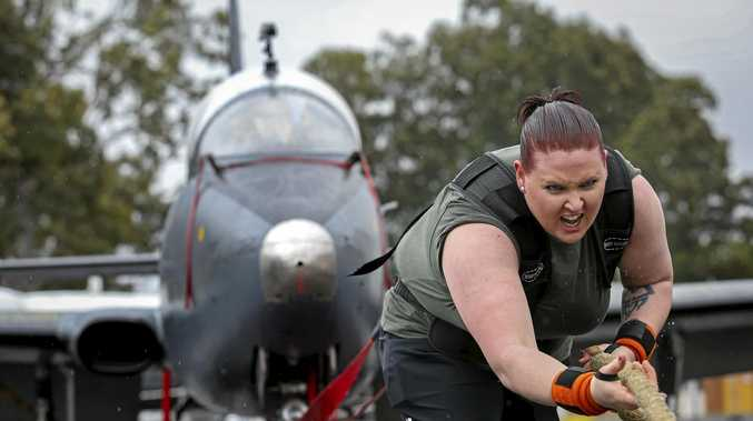WE HAVE TAKEOFF: Tiffany Cameron pulls an A7 Macchi aircraft during her record attempt.
