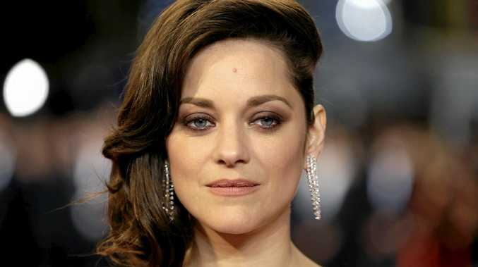 FILE - In this May 19, 2016 file photo, actress Marion Cotillard poses for photographers upon arrival at the screening of the film Juste la Fin du Monde (It's Only the End Of The World) at the 69th international film festival, Cannes, southern France. Cotillard is announcing her pregnancy and shooting down rumors of any romantic involvement with Brad Pitt. The actress says in a statement posted Wednesday, Sept. 21, 2016, on Instagram that she is \