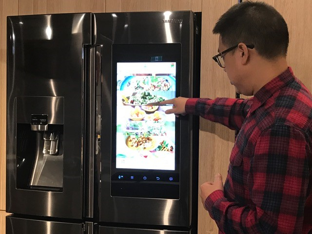 Chef Dan Hong checks out some of the 2200 recipes in the Samsung Family Hub fridge.