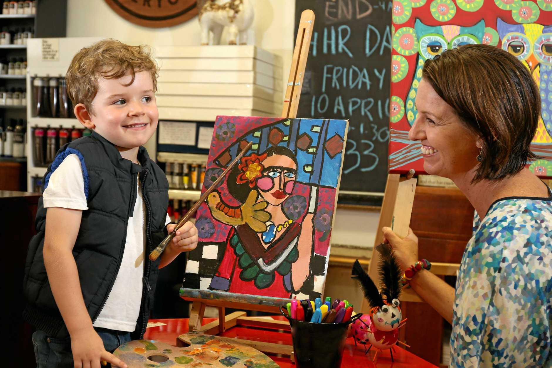 Gillian Grove from Artable in Kingscliff with Saxon Leiper painting Frida Kahlo which is one of the many art classes kids will be able to do during the school holidays.  Photo: Nolan Verheij-Full / Tweed Daily News