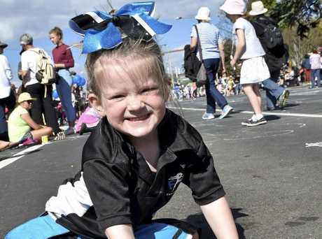 BEAUTIFUL DAY: Clare Breay enjoys some colourful drawing during the Carnival parade.