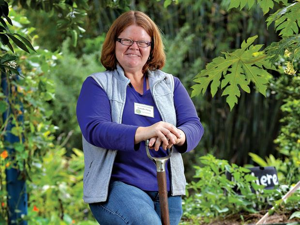 RAY OF SUNSHINE: Working at the permaculture garden at Yandina has helped Michelle Parry to reconnect with the community.