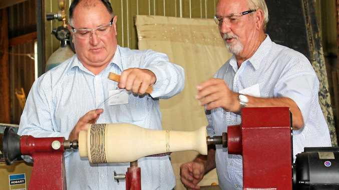Under the watchful eye of Clive Barton (right) The late LVRC Mayor Steve Jones tried his hand at operating a wood lathe in the Lockyer Valley Community Activities Shed.