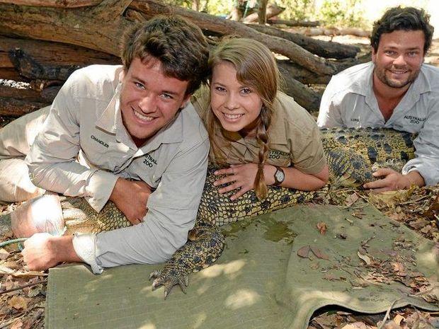 Chandler Powell, Bindi Irwin and team member Luke with Madison the Crocodile.