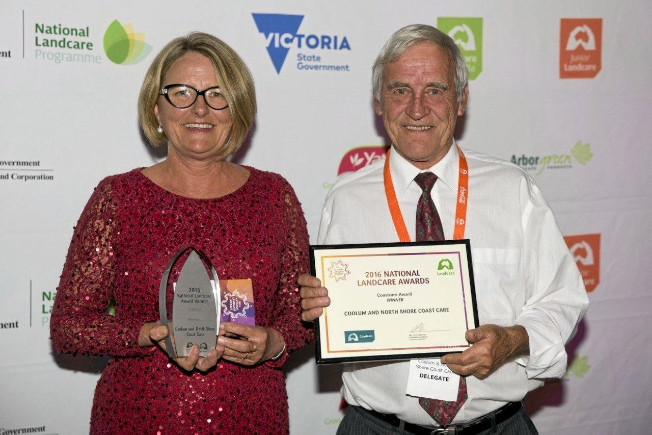 Leigh Warneminde and Edwin Hammet accept the 2016 National Coastcare Award in Melbourne.
