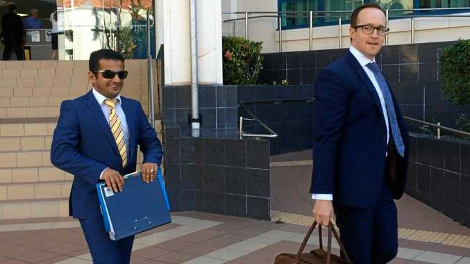 Petros Khalesriad and lawyer Kris Jahnke leave Rockhampton Court House after having their bail variation application dismissed.