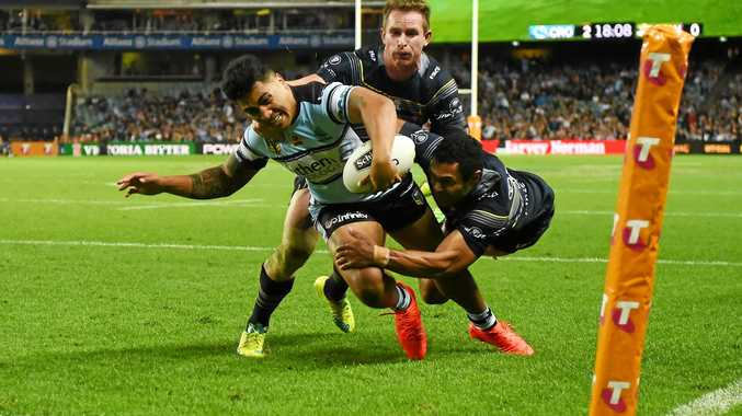 HE'S IN: Sharks winger Sosaia Feki scores a try despite the efforts of the Cowboys Justin O'Neill and Michael Morgan during the NRL preliminary final at Allianz Stadium in Sydney.