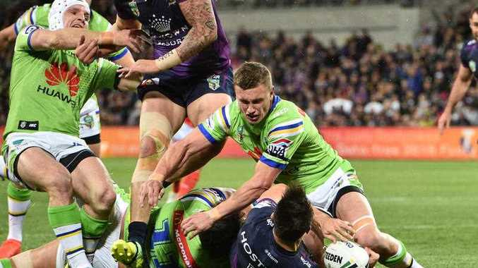 Jarrod Croker (left) of the Raiders is seen injuring his knee during the NRL preliminary final between the Melbourne Storm and the Canberra Raiders at AAMI Park in Melbourne, Saturday, Sept. 24, 2016.