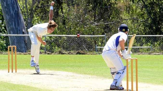 Ipswich Hornets bowler Adam Smith toils hard against Sandgate Redcliffe at Baxter Oval.